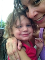 Hanging out with momma on a hot summer day in Greenpoint, 2013