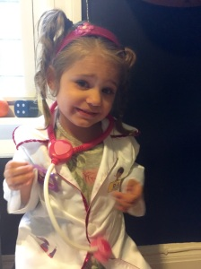 L playing dress-up as Doc McStuffins